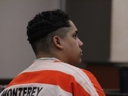 Gonzalo Curiel, 20, on Tuesday watches silent footage of him allegedly telling authorities the location of a storage unit with the bodies of two children inside.