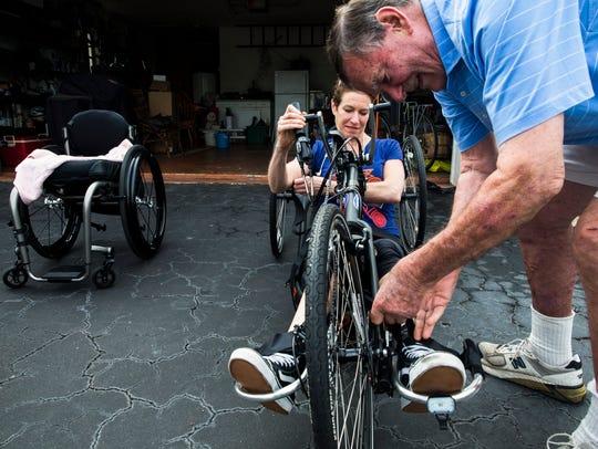 Jim Perkins helps his daughter, Edie Perkins, onto