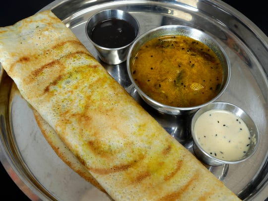 Indian Delight serves dishes from northern and southern India; one stemming from the south is masala dosa, the large crepe that's stuffed with seasoned potato and onion.
