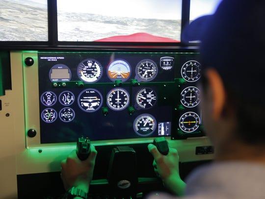 Angel Martinez inside the new flight simulator at the