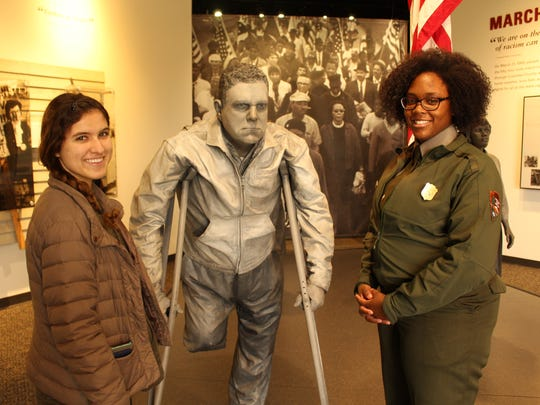 Julia Glass, left, and Park Ranger April Baldwin stand next to a statue of civil rights activist Jim Letherer Saturday at the Lowndes Interpretive Center. Alvin Benn/Special to the Advertiser