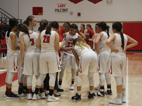 The Lady Falcons discuss plays during a 30-second timeout at Friday's game at home against Tatum. The team lost 60-73 to the Coyotes.