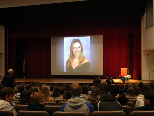 A slide presentation, including a portrait of 1st Lt. Ashley Henderson-Huff, was part of an assembly for juniors and seniors honoring her memory at Montgomery High School.