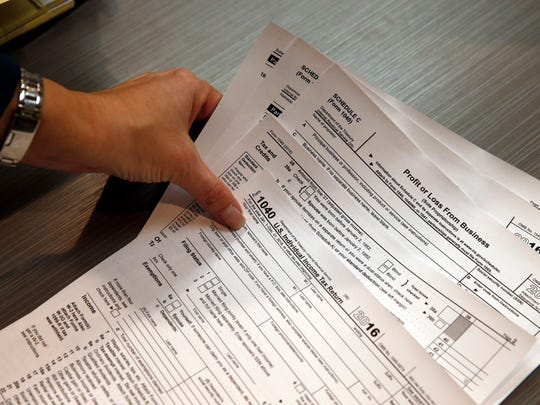 Although the tax filing season officially opens Jan. 29, taxpayers starting today can begin preparing and e-filing their taxes for free with IRS Free File software. Free File software will automatically submit returns as soon as the filing season begins.(AP Photo/Brennan Linsley)
