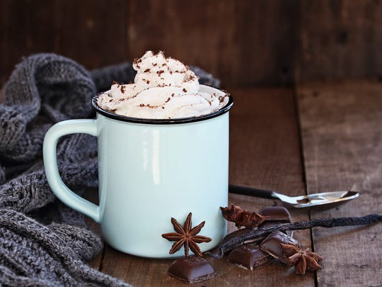 Cup of hot cocoa with whipped cream, shaved chocolate,