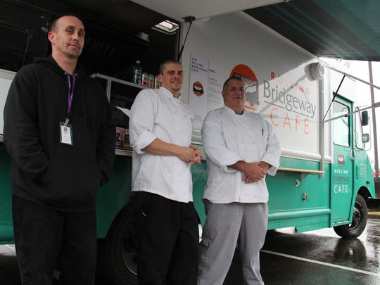 Jessy Powell, Matt Wangler and John Simmons stand outside Bridgeway's new food truck, the Rolling Bridgeway Cafe.