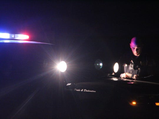A Salinas police officer investigates a shooting on Russell Road Wednesday evening.