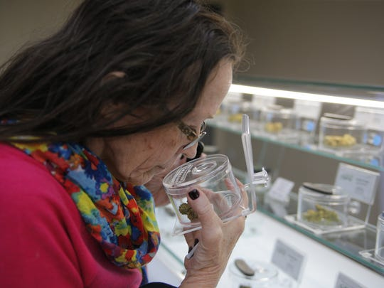 Kathy Stoudt visiting Salinas' first recreational dispensary, Emerald Skyway.
