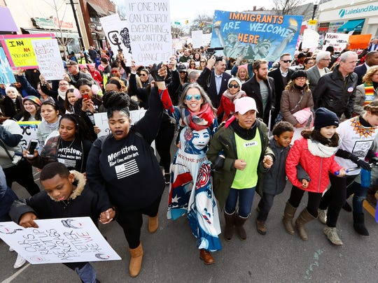 Thousands march down South Street in Morristown during