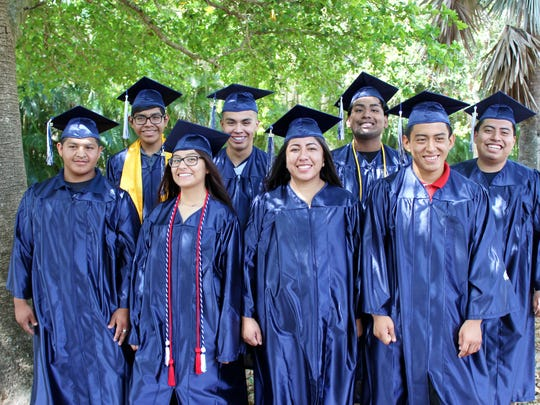 A group of 2017 Super Teen Club high school graduates pose for a photo.