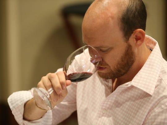 Timothy Houdek, Tavern Americana, sniffs a wine during