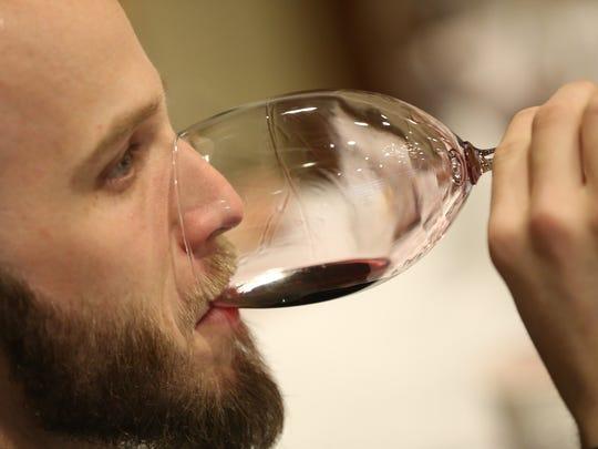 Jordan White, Vinum, tastes one of the wines during