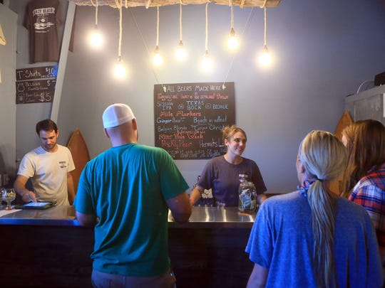 Customers order drinks at the Lazy Beach Brewing Co. Saturday Sept. 5, 2015 in Corpus Christi.