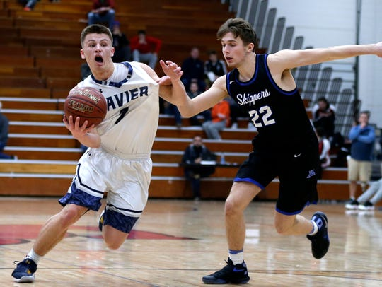 Xavier's Hunter Plamann drives to the basket against