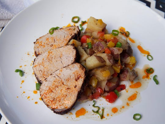 Southwest pork tenderloin rests on a bed of diced potato