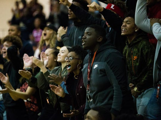 West Creek fans cheer on their team during their game