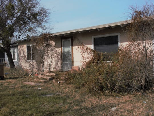 Owners of the 1922 Spaulding residence asked Construction Board members to spare their house from demolition by granting the time to do the necessary repairs to ensure it is safe and secure.
