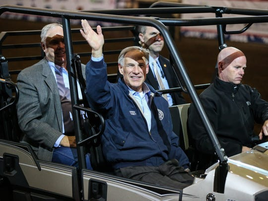 Governor Greg Abbott waves at the audience at the start of the 1st performance of the San Angelo Stock Show and Rodeo Friday, Feb. 2, 2018, at Foster Communications Coliseum.