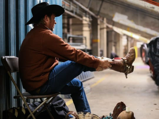 A rider gets ready during the 1st performance of the San Angelo Stock Show and Rodeo Friday, Feb. 2, 2018, at Foster Communications Coliseum.