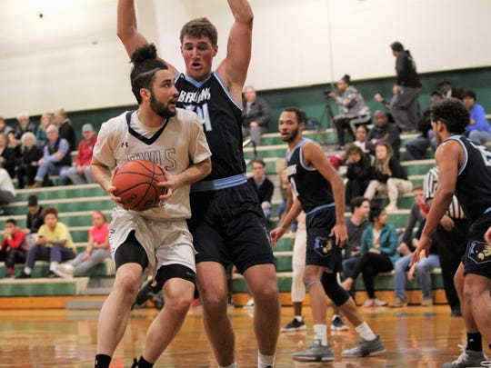 Warren Wilson College senior Michael Pomeroy works his way past a Bob Jones University defender in a 99-88 Owls loss at home on Jan. 30.