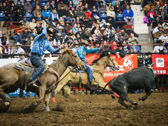 Cody Snow and Wesley Thorp ride out in team roping during the 2018 San Angelo Stock Show & Rodeo.