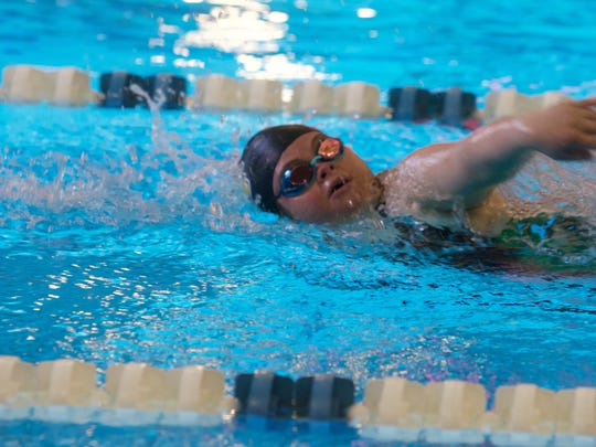 Local swimmers compete at the 4A state championships.