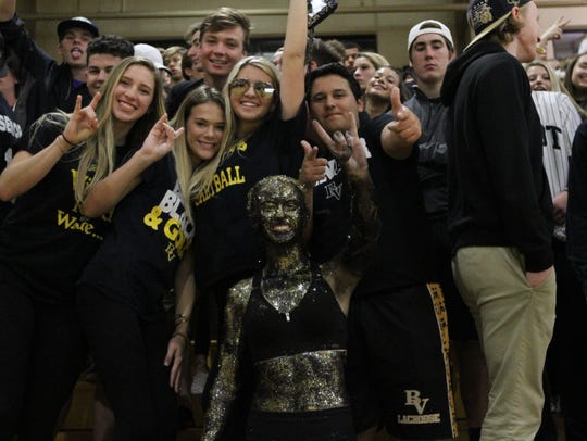 The Bishop Verot student section poses during a break in the action of a Feb. 11 basketball game between the Vikings and Fort Myers at John J. Nevins Gymnasium. Administrators said the game won't be played in 2019.