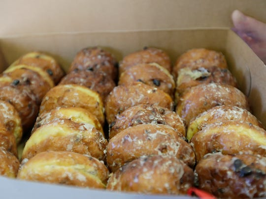 A various assortment of paczki from National Bakery & Deli are boxed up for Paczki Day.
