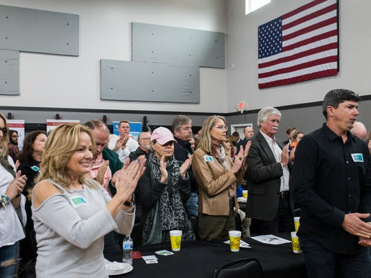 People clap after Texas Gov. Greg Abbott announces new hazard mitigation funding for Hurricane Harvey damage during the Rockport-Fulton Chamber of Commerce luncheon Tuesday, Feb. 13, 2018, at Rockport Health and Fitness Club.