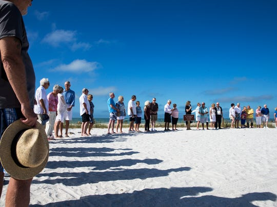 40 couples renew their vows together on the beach at Lovers Key State Park on Wednesday, Feb. 14, 2018.