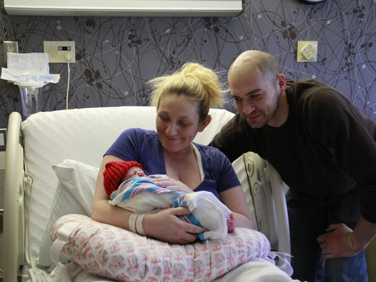 Michael and Hayley Vignoli with their daughter, Aurora Gabrielle, born at 4:05 a.m. Feb. 1. Aurora weighed 8 pounds, 6 ounces and was 20.5 inches long.