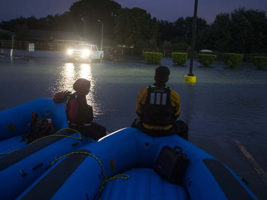 Theresa Reyes and Estaban Guzman, swift-water rescue technicians with Help.NGO's Global Disaster Immediate Response Team, help with the evacuation in Port Arthur, Texas. on Aug. 31, 2017.
