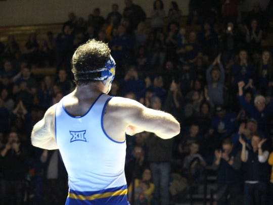SDSU's Nate Rotert flexes his muscles to the crowd