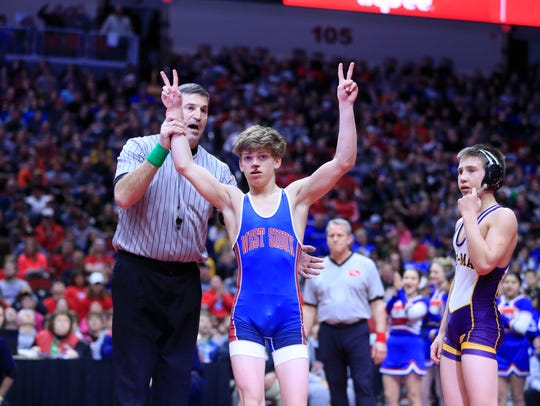 Adam Allard of West Sioux wins the state championship