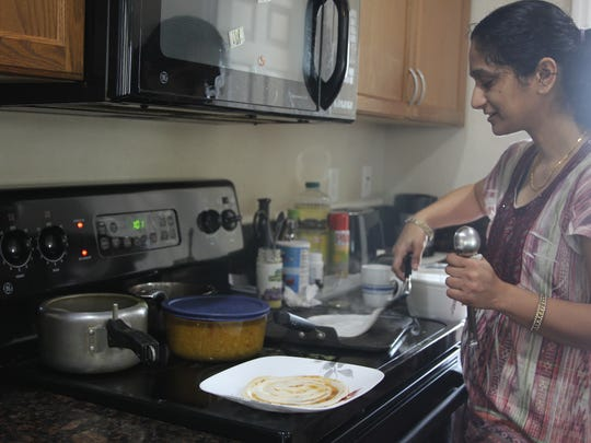 Chitra Mony, 42, a family medicine physician at Tallahassee Memorial HealthCare, makes dosas, lentil and rice pancakes, at her Southwood home Saturday, Feb. 17.