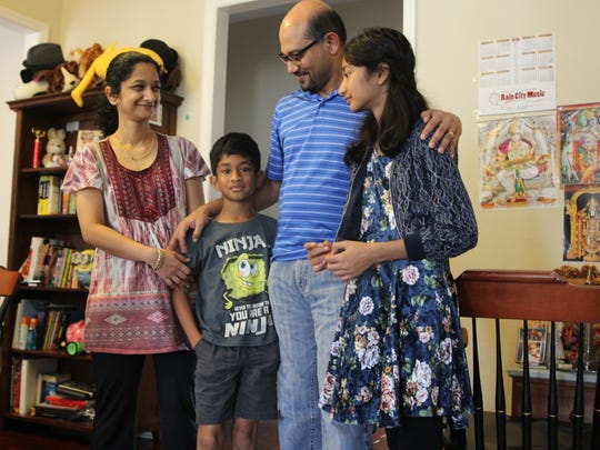 Chitra Mony, left, and Narayanan Krishnamoorthy, middle, with their kids Sreyas, 8, and Luxmi, 13.
