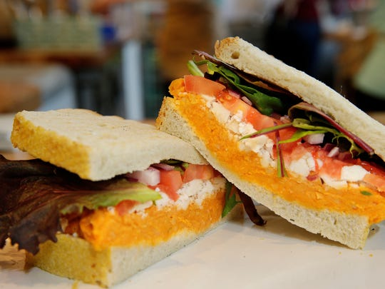 Smashed Buffalo chickpea spread goes on sourdough in this sandwich from On the Bus vegan restaurant.