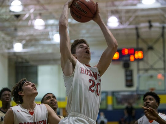 Will Midlick, 20, jumps for the shot during Rossview's