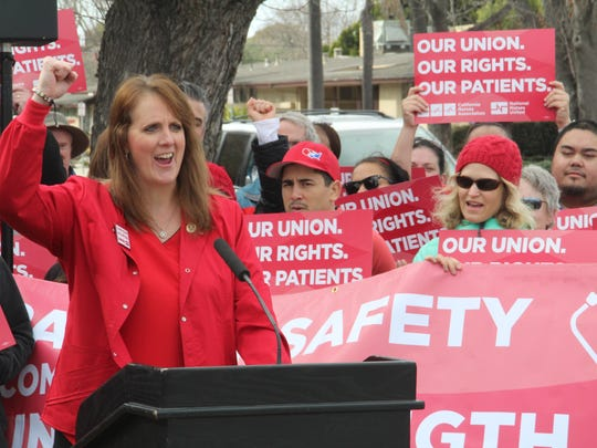 Monica Benton, a registered nurse at Hazel Hawkins Memorial Hospital in Hollister, finishes a speech Thursday praising unions. When she worked in Texas in a non-union shop, administrators there retaliated against her after she complained they'd put too many patients under her supervision.