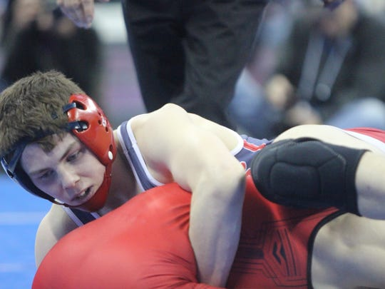 Connor Thorpe of Brookfield East battles with Chance Bailey of Stevens Point in the opening round of the WIAA Division 1 state meet in Madison. Thorpe lost the match, 8-6.