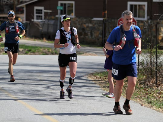 Runners in the 21st annual Mount Mitchell Challenge and Black Mountain Marathon make their way along East Cotton Avenue before turning onto the Flat Creek Greenway in the final stretch of the Feb. 24 race.