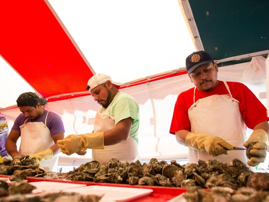 Oysters are shucked and served on the half shell during the 37th Annual Fulton Oysterfest in Fulton Texas, Saturday, Mar. 5, 2016.