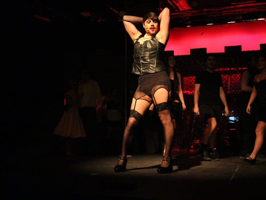 """Tony Baer performs during a rehearsal of The Ohio State University-Mansfield's production of """"The Rocky Horror Picture Show"""" on Tuesday. Baer plays Dr. Frank'N'Furter."""