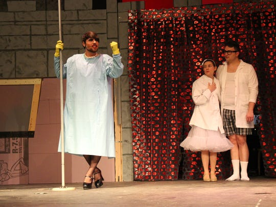 """(From left to right) Tony Baer, Lindsey Saltz and Andrew Weber perform during a rehearsal of The Ohio State University at Mansfield's production of """"The Rocky Horror Picture Show"""" on Tuesday, Feb. 27, 2018. Baer plays Dr. Frank 'N'Furter, Saltz plays Janet and Weber plays Brad."""
