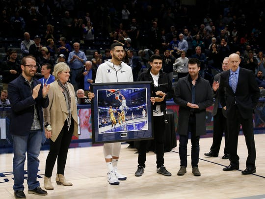 Xavier Musketeers forward Kerem Kanter (11) is honored