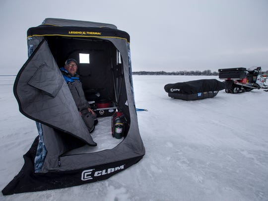 Chad Loreth demonstrates one of his thermal ice shacks on West Lake Okoboji.
