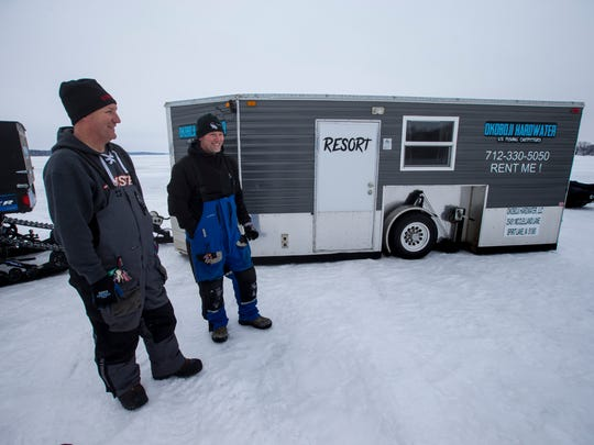Rich Menken and Chris Quiring of Okoboji Hardwater ice fishing outfitters stand outside one of their ice castles on West Lake Okoboji.