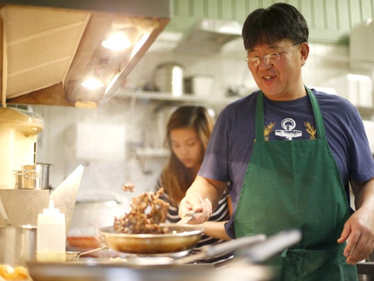 Seunghwan Lee, the owner of Korean BBQ and More, flips