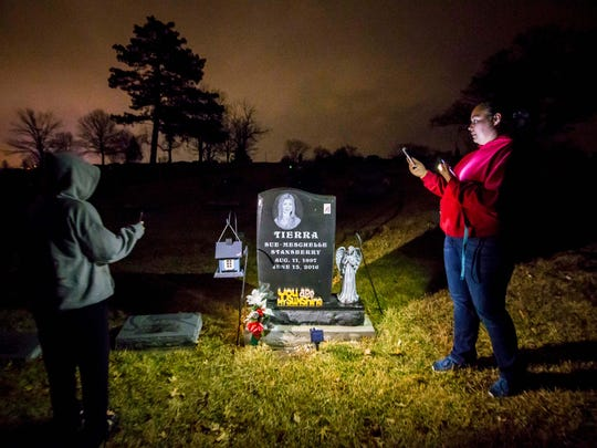 Josalyn Stansberry, Tierra's sister, and Kimberly Roberts, a family member, right, at the gravesite of Tierra Stansberry Wednesday, Feb. 28, 2018, in Ottumwa, Iowa. The family visits the site every day since her burial after a fire in 2016 in Los Angeles.