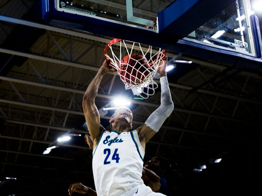 Florida Gulf Coast University forward Michael Gilmore, #24, dunks the ball during the ASUN tournament semifinal game against North Florida at Alico  Arena on Thursday, March 1, 2018.